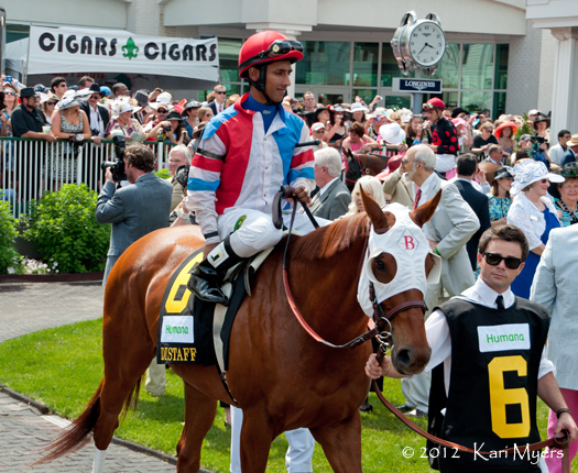 May 5, 2012: Rajiv Maragh and Groupie Doll head out of the paddock to set a new track record in the Humana Distaff.
