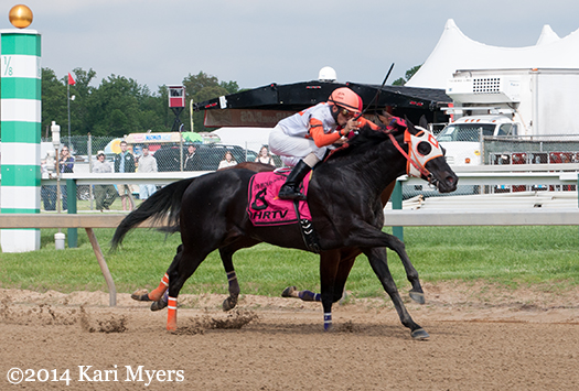 May 16, 2014: Ben's Cat passes Great Attack in the Pimlico stretch.